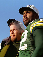 """Green Bay Packers quarterback Brett Favre and defensive end Reggie White on the trophy presentation podium at the conclusion of the NFC Championship in which the Packers defeated the Carolina Panthers 30-13 on January 12, 1997. This was the first title game in Green Bay since the """"Ice Bowl"""" in 1967."""