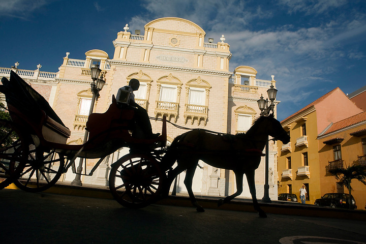CARTAGENA, COLOMBIA - AUGUST:  A horse drawn carraige passes in front of the Teatro Heredia in Cartagena, Colombia in August 2007.  (Photo by Dennis Drenner/Aurora)..