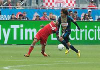 15 September 2012: Philadelphia Union midfielder/defender Gabriel Farfan #15 and Toronto FC midfielder Luis Silva #11 in action during an MLS game between the Philadelphia Union and Toronto FC at BMO Field in Toronto, Ontario Canada. .