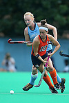 12 September 2014: Syracuse's Lauren Brooks (in orange) and North Carolina's Nina Notman (GER) (behind). The University of North Carolina Tar Heels hosted the Syracuse University Orange at Francis E. Henry Stadium in Chapel Hill, North Carolina in a 2014 NCAA Division I Field Hockey match. UNC won the game 3-0.
