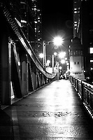 Chicago bridge walkway at night in black and white.