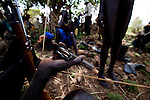 A elder warrior checks his bullets at a gathering in Jonglei state.