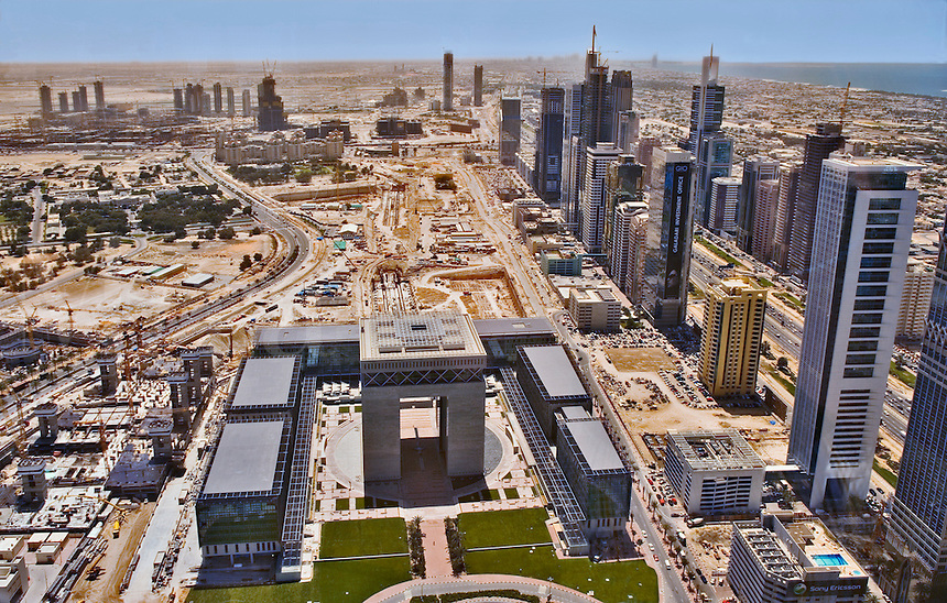 Aerial view of The Gate development, Dubai?s International Stock Exchange.  Tall buildings along Sheikh Zayed Road and the central business area under construction.  Dubai, United Arab Emirates.