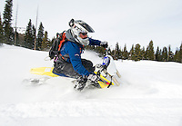 NEWS&amp;GUIDE PHOTO / PRICE CHAMBERS.With the front ski buried in powder, Randy Schrauder carves turns through a meadow near Phillip's Canyon on Friday. While a snowbike lacks the stability of a wheel's gyroscopic motion, the snowmobile-like track provides ample contact with the surface as you wind through the gears.