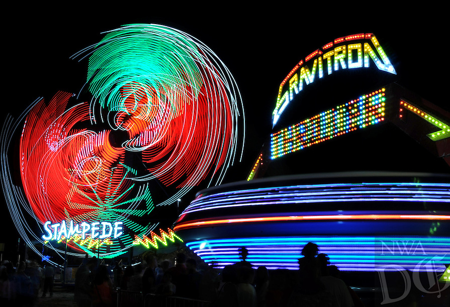 NWA Media/BEN GOFF  @NWABenGoff -- 08/16/14 Rides swirl into a blur of color during the Benton County Fair near Bentonville on Saturday August 16, 2014.