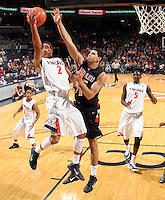 Dec. 22, 2010; Charlottesville, VA, USA; Virginia Cavaliers guard Mustapha Farrakhan (2) is defended by Seattle Redhawks guard Cervante Burrell (5) during the game at the John Paul Jones Arena. Seattle Redhawks won 59-53. Mandatory Credit: Andrew Shurtleff