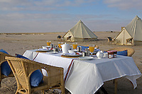 Breakfast is taken al fresco at laid tables on the beach infront of the line of tents