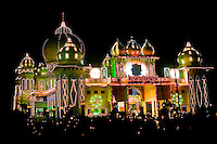 Illuminated fairground decorated with lights on the road between Agra and Delhi. (Photo by Matt Considine - Images of Asia Collection)