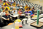 Medford and Somerville children watch the Chemistry Show at Kids Day 2012. (Matthew Modoono for Tufts University)