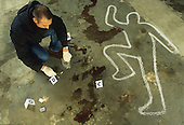 Crime scene investigator gathering forensic evidence.