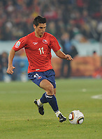 Chile's Mark Gonzalez brings ball upfield. Spain won Group H following a 2-1 defeat of Chile in Pretoria's Loftus Versfeld Stadium, Friday, June 25th, at the 2010 FIFA World Cup in South Africa..