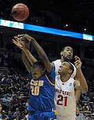 UC Santa Barbara's Will Brew is hit hard while trying to score against Ohio State's Evan Turner (21) and David Lighty during the NCAA first round playoff game in Milwaukee on Friday, March 19, 2010. UC Santa Barbara photo by Ernie Mastroianni