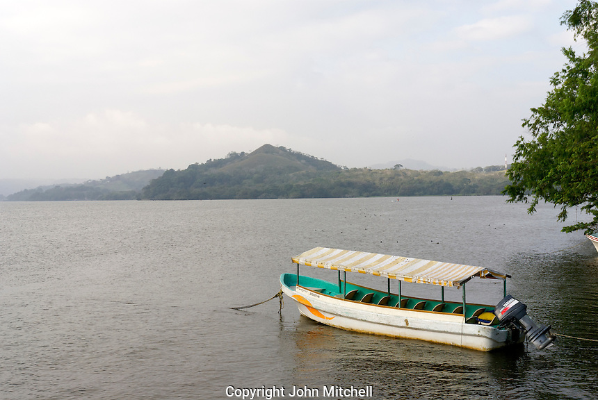 Motorized tourist launch moored on Lake Catemaco on a cloudy day, Catemaco, Veracruz, Mexico