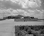 Pittsburgh PA 1952: View of the entrance to the Greater Pittsburgh Airport in 1952. In 1944, Allegheny County officials proposed to expand the military airport with the addition of a commercial passenger terminal in order to relieve the Allegheny County Airport, which was built in 1926 and whose capacity was quickly becoming insufficient to support the growing demand for air travel.  The new airport, christened as Greater Pittsburgh Airport opened on May 31, 1952. The first flight occurred on June 3, 1952.