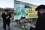 Ultra-Orthodox Jewish men walk along during a protest against a planned construction of a new neighborhood, in the town of Ramat Beit Shemesh. They claim the designated construction area is full of ancient burial caves.