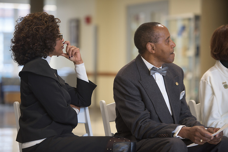 Dean Renee Middleton, left, and Emeriti Faculty member, Glenn Doston, listen on as President McDavis addresses the ribbon cutting ceremony for the Gladys W. and David H. Patton College of Education's newly renovated McCracken Hall held on January 27, 2017.