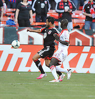 Carlos Ruiz (20) of D.C. United goes against Pa Modou Kah (44) of the Portland Timbers. The Portland Timbers defeated D.C. United 2-0, at RFK Stadium, Saturday May 25 , 2013.