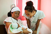 Myleene Klass, a high profile UK celebrity, TV host, violinist and pianist, visits Arlene, 34, a new mother and Hans, her 1 day old baby, who has been breastfed since birth, in the Florencio V. Memorial Hospital in Paranaque city, Metro Manila, The Philippines on 19 January 2013. Photo by Suzanne Lee for Save the Children UK