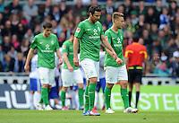 FUSSBALL   1. BUNDESLIGA   SAISON 2011/2012   34. SPIELTAG SV Werder Bremen - FC Schalke 04                       05.05.2012 Sokratis Papastathopoulos, Claudio Pizarro und Tom Trybull (v.l., alle SV Werder Bremen) sind enttaeuscht