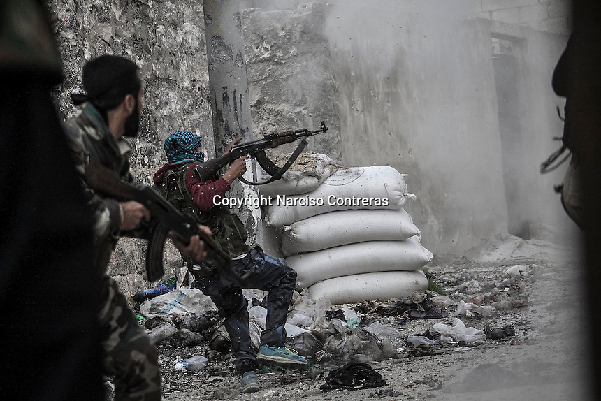 In this Wednesday, Oct. 24, 2012 photo. A rebel fighter retrets for cover as enemy fire targets the rebel position during clashes at the Moaskar front line, one of the battlefields in Karmal Jabl neighborhood, northeast of Aleppo City. (AP Photo/Narciso Contreras).