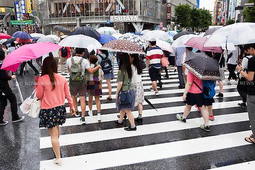 Pedestrians hold umbrellas in the rain at Shibuya scramble crossing on July 9, 2016, Tokyo, Japan. The annual rainy season or Tsuyu in Japan runs from June until mid-July. (Photo by Rodrigo Reyes Marin/AFLO)