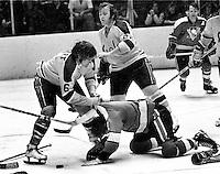 California Golden Seals Bob Stewart beats up on Pittsburg Penguin #7   (1968 photo/Ron Riesterer)