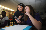Lafayette Middle School student Jennifer Nail (right) uses a clicker to answer questions projected from a learning tablet in Penny Allen's class on Thursday, January 14, 2010.