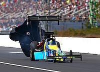 Mar 15, 2014; Gainesville, FL, USA; NHRA top fuel dragster driver Sidnei Frigo during qualifying for the Gatornationals at Gainesville Raceway Mandatory Credit: Mark J. Rebilas-USA TODAY Sports
