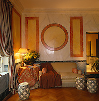 The walls of the living room have been marbleised and hand-painted with bold motifs by artist Peter Farlow
