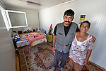 Milan Pesic and his wife Gordana pose inside the shipping container that has been converted into their home in Makis, a village outside of Belgrade, Serbia. They and dozens of other Roma families were evicted from Bellville, an urban squatter settlement, in 2012 to make way for construction of new apartments and office buildings. The shipping containers they now call home, which were provided at no cost by local authorities, are far from the city center.