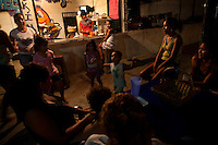 Acapulco, Mexico, February 17, 2012 – young girls gathered around a taco stand in the community on the Bahia De Puerto Marquez.