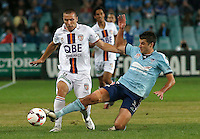 Sydney FC Terry Antonis (R) challenges Perth Glory Nebojsa Marinkovic during their A-League match in Sydney, April 13, 2014. Photo by Daniel Munoz/VIEWPRESS EDITORIAL USE ONLY