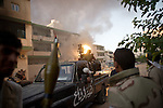 Remi OCHLIK/IP3 PRESS - On august, 25, 2011 In Tripoli - Rebels fighters in Abu Slim neighborhood against the last resistance of the Gadaffi loyalist forces. They captured some african people supposed to be Gadaffi mercenaries and snippers - At the end of the day rebels try to pull out remaining snippers from a building.