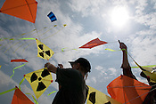 "LUTZ TRECZOCKS AND HIS ""STOP PLUTONIUM"" KITES, MVAS.. aboard the Greenpeace ship Arctic Sunrise, as she departs for Takahama Bay, in Japan. 3rd July 2002."
