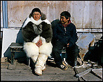 Visions of past and present - two Inuit boys sit in the sun of a late Spring day in Siorapaluk, Greenland - the northernmost continuously inhabited community on Earth. A changing climate - which shows itself in warming temperatures, earlier summers, later winters, and shrinking and thinning sea ice - threatens the livelihoods and traditions of some of the last subsistence hunters on Earth, the Polar Inuit communities of far Northwest Greenland.