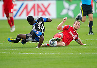 25 September 2010:  Toronto FC forward Chad Barrett #19 and San Jose Earthquakes defender/midfielder Brandon McDonald #14 in action during a game between the San Jose Earthquakes and Toronto FC at BMO Field in Toronto..San Jose Earthquakes won 3-2...