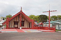 Maori Marae (Meeting House), Ohinemutu Village, Rotorua, north island, New Zealand.  This house also serves as a meeting place for the traditional Maori parliament for the northern Maori tribes.  Rebuilt 1942-43.  The figure (tekoteko) at the top of the gable above the entrance is Chief Tematekapua, captain of the Te Arawa canoe which arrived in New Zealand (Aotearoa) in 1350.