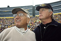 Fuzzy Thurston and Donny Anderson on the sidelines during an alumni game.
