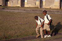 Two Belizian boys on their way to school in Belmopan, Belize