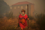 A woman is seen in wildfire in Mandín Cualedro, Ourense on August 24, 2013 (c) Pedro ARMESTRE.