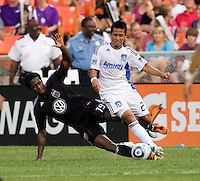 Clyde Simms (19) of D.C. United tackles Anthony Ampaipitakwong (23) of the San Jose Earthquakes celebrates his first goal during the game at RFK Stadium in Washington, DC.  D.C. United was defeated by the San Jose Earthquakes, 4-2.