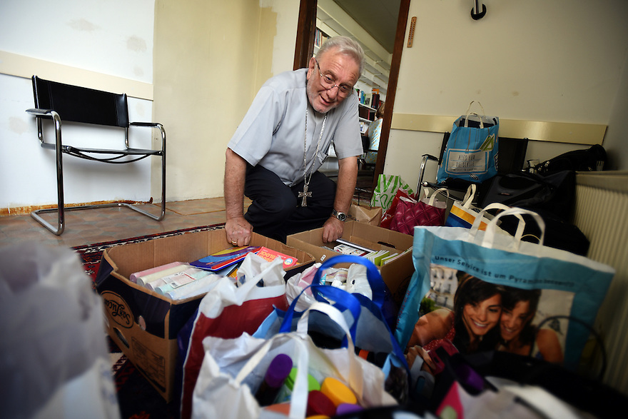REFUGEE CRISIS IN AUSTRIA. THE SYRIAN ORTHODOX CHURCH OF VIENNA WHICH IS HELPING REFUGEES. CHOREPISKOPS EMMANUEL AYDIN WITH DONATIONS FOR REFUGEES. PHOTO BY CLARE KENDALL. 12/08/15.