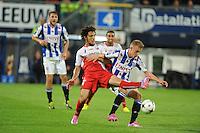 VOETBAL: HEERENVEEN: Abe Lenstra stadion 30-08-2014, SC Heerenveen - FC Utrecht uitslag 3-1, Daley Sinkgraven(r) in duel, ©foto Martin de Jong