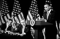 President Barack Obama answers questions from Senate Democrats during their retreat at the Newseum in Washington on Feb. 3, 2010. To the left are Sen. Byron Dorgan, D-N. Dak., Sen. Richard Durbin, D-Ill., and Senate Majority Leader Harry Reid, D-Nev.
