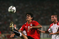 Egypt's Ahmed Hegazy (6) takes control of the ball against Costa Rica's Jorge Castro (9)  during the FIFA Under 20 World Cup Round of 16 match between Egypt and Costa Rica at the Cairo International Stadium on October 06, 2009 in Cairo, Egypt.