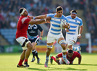 Pablo Matera of Argentina fends Tukulua Lokotui of Tonga. Rugby World Cup Pool C match between Argentina and Tonga on October 4, 2015 at Leicester City Stadium in Leicester, England. Photo by: Patrick Khachfe / Onside Images