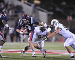 Ole Miss quarterback Bo Wallace (14) vs. Vanderbilt defensive tackle Jared Morse (97) and Vanderbilt defensive end Walker May (90) at Vaught-Hemingway Stadium in Oxford, Miss. on Saturday, November 10, 2012. (AP Photo/Oxford Eagle, Bruce Newman)