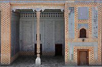 View from the front of an aiwan terrace in the Harem, Tash Khauli Palace, 1830-38, Khiva, Uzbekistan, Khiva, Uzbekistan, pictured on July 6, 2010, in the morning. Commissioned by Allah Kuli Khan the Tash Kauli palace is a huge complex containing 163 rooms which took its architects, Tajiddin and Kalandar, 10 years to build. The harem, occupying about half of the palace has 5 aiwan terraces, with delicately carved wooden pillars,  behind which were the quarters for the khan and his wives. Khiva, ancient and remote, is the most intact Silk Road city. Ichan Kala, its old town, was the first site in Uzbekistan to become a World Heritage Site(1991). Picture by Manuel Cohen.