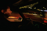 Rush hour traffic with woman looking out windshield at cars break lights in rain in tunnel Seattle Washington State USA  MR