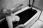 Baku, Azerbaijan <br /> December 12, 2006<br /> <br /> The country is so rich in oil that people use it to bath in for health reasons.<br /> <br /> At the Naftalan Medical Center in Baku, a company that imports this special oil from a region in Azerbaijan, uses the oil to cure many health problems as people bath in it to cure their ills.